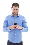 Handsome arabic man in blue shirt with smartphone isolated on wh Stock Photo