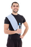 Handsome arabic man in sportswear with bottle of water isolated Stock Photography
