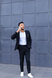 Handsome arabic man talks on smart phone in business center Stock Photography