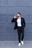 Handsome arabic man talks on smart phone in business center Stock Image