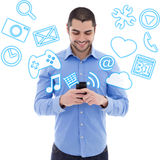 Handsome arabic man using smartphone and media icons over white. Background Stock Photo