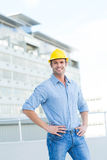 Handsome architect with hands on hips outdoors Stock Photos
