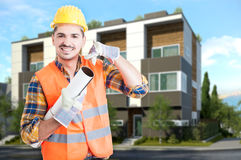 Handsome architect holding construction project Royalty Free Stock Photos