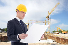 Handsome architect man in builder helmet at construction site Royalty Free Stock Photography