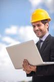 Handsome architect man holding laptop. Royalty Free Stock Photo