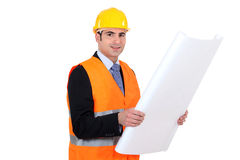 Handsome architect with plans Royalty Free Stock Image