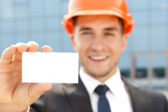 Handsome architect showing business card Royalty Free Stock Photo