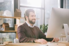 Handsome architect working with computer in office. With backlit stock photos