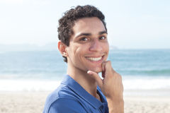 Handsome argentinian guy at beach Stock Photography