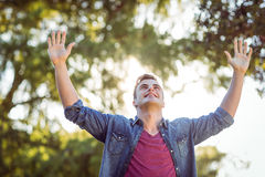 Handsome arms raised hipster Stock Photos