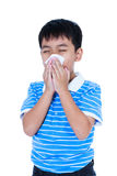 Handsome asian boy blowing his nose into tissueon. Isolated on w. Childhood, healthcare and medicine concept. Handsome asian boy blowing his nose into tissue Royalty Free Stock Photo