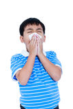 Handsome asian boy blowing his nose into tissueon. Isolated on w. Childhood, healthcare and medicine concept. Handsome asian boy blowing his nose into tissue Stock Photo