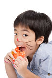 Handsome asian boy eating a toy crab Royalty Free Stock Images