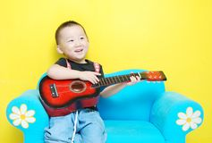 Handsome Asian  boy with guitar Royalty Free Stock Images