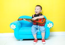 Handsome Asian  boy with guitar Stock Photos