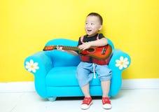 Handsome Asian  boy with guitar Stock Photos