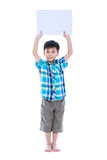 Handsome asian boy showing blank sign or blank paper, studio sho Royalty Free Stock Image