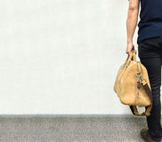 Handsome Asian Business Man Holding Big Brown Leather Bag in Retro Style Ready to Go For Travel Stock Photography