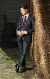 Handsome Asian Businessman on the Farm Royalty Free Stock Images