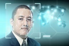 Handsome asian businessman using face recognition stock image