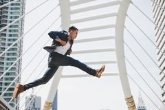 Handsome asian guy is running fast and jumping highly. Attractiv stock photos