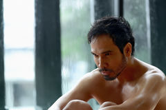 Handsome asian male athlete resting Stock Photography
