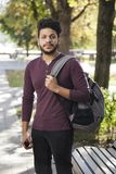 Handsome asian man with backpack in park.  royalty free stock images