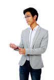 Handsome asian man buttoning his jacket Stock Images