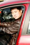 Handsome asian man in the car. Young handsome asian man in the car,great shot for auto insurance, safe driving, auto sales ads etc Stock Photos