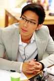 Handsome asian man in glasses at office Stock Image