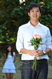 Handsome Asian Man Holding A Bouguet Of Flowers Stock Photo