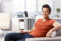 Handsome Asian man at home smiling royalty free stock photo