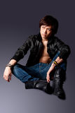 Handsome Asian man with leather jacket Royalty Free Stock Photography
