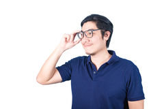 Handsome Asian man looking up while holding glasses with hand, i Royalty Free Stock Images