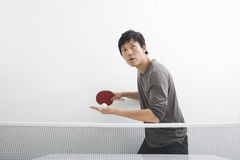 Handsome Asian man playing ping pong Royalty Free Stock Images