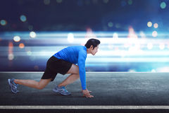 Handsome asian man runner with ready position for running Royalty Free Stock Photography