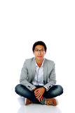 Handsome asian man sitting on the floor Stock Photography