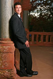 Handsome Asian Man Smiling in a Black Suit Royalty Free Stock Photos