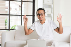 Handsome Asian man using tablet computer Stock Images