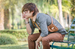 Handsome Asian man is waiting for someone Royalty Free Stock Image