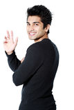 Handsome Asian man waving Royalty Free Stock Photo