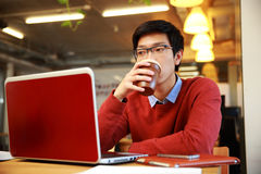 Handsome asian man working on laptop Royalty Free Stock Photos