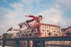 Handsome Asian model jumping in the city streets Stock Images