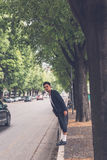 Handsome Asian model posing in the city streets Royalty Free Stock Image