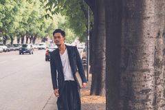 Handsome Asian model posing in the city streets Stock Photo