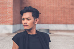Handsome Asian model posing in the city streets Royalty Free Stock Photos