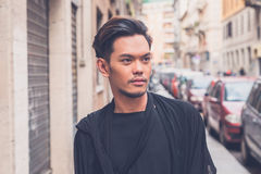Handsome Asian model posing in the city streets Stock Photography