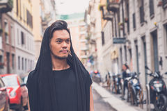 Handsome Asian model posing in the city streets Royalty Free Stock Photography