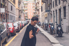 Handsome Asian model posing in the city streets Royalty Free Stock Photo