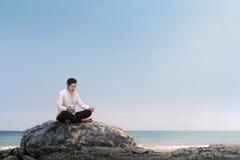 Handsome asian muslim man praying with prayer beads Stock Image